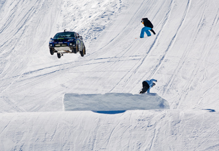 Rally Car Snowboard Jump